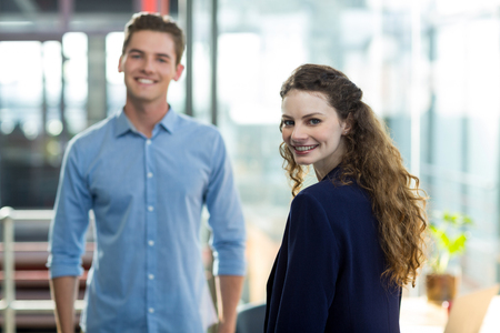 Portrait of smiling business executives standing in office Stock Photo