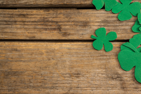 lucky charm: St. Patricks Day shamrocks on wooden table