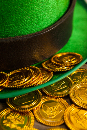 shinning: St Patricks Day close-up of leprechaun hat with gold chocolate coins