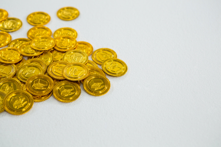 St. Patricks Day chocolate gold coins on white background Stock Photo