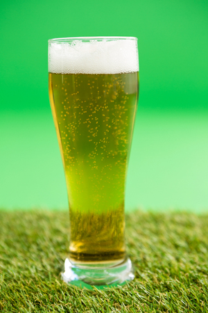 shinning: St Patricks Day glass of beer on grass Stock Photo