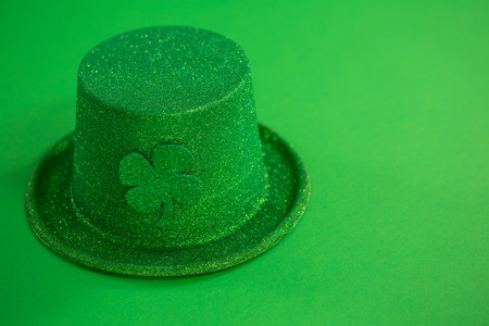 St Patricks Day leprechaun hat with shamrock on green background