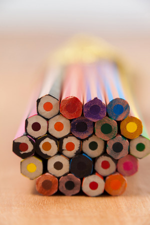Bunch of colored pencil on wooden background Stock Photo