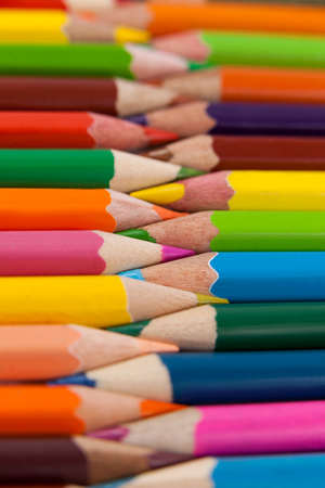 Close-up of colored pencils arranged in interlock pattern