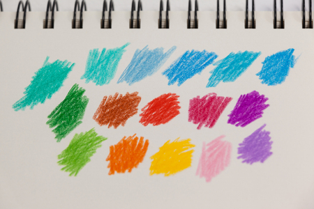 Close-up of hand drawn colorful stripes on note book Stock Photo