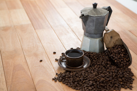 Coffee with coffeemaker and scoop on wooden table Stock Photo