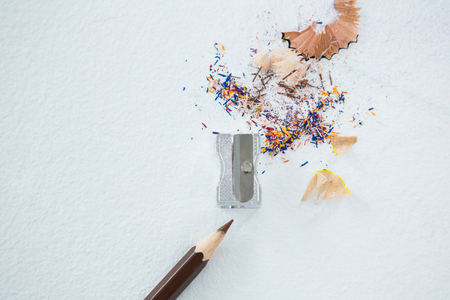Colored shavings with brown color pencil on white background Stock Photo