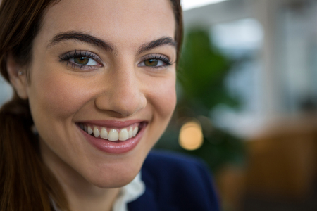 Portrait of smiling female executive in creative office Stock Photo