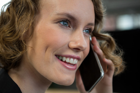 Close-up of happy woman talking on mobile phone Stock Photo
