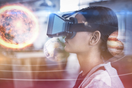 side viewing: Composite image of solar system against white background against businesswoman using virtual reality simulator 3D