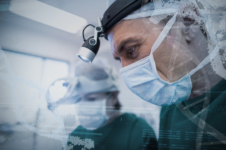 Panoramic view of helix pattern information on device screen against doctors with mask performing operation