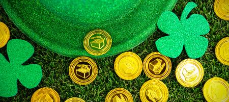 St Patricks Day leprechaun hat shamrocks and chocolate gold coins on grass Stock Photo