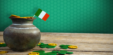WBMPE047_pad_pat_mix_04 against jar of golden coins and shamrocks Stock Photo