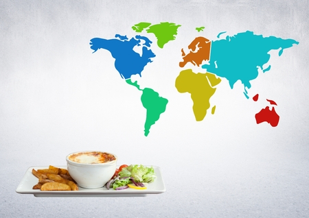 Digital composite of World balanced meal against a world map on a neutral background Stock Photo