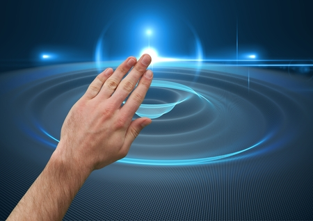 Digital composite of Hand Touching Orb Sphere against blue background