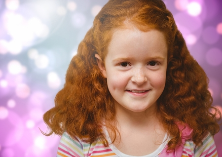 Digital composite of happy red-headed girl against bright Colourful Background