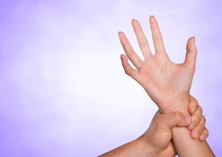 Digital composite of Hands retaining against purple background