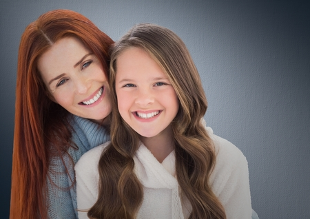 Digital composite of a lovely girl with her mom against neutral background