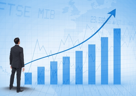Digital composite of Businessman Standing and looking at Graph