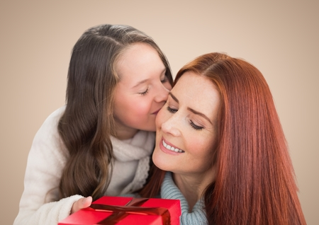 Digital composite of a girl offering a gift to her mother against a beige background Stock Photo