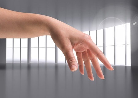 cropped: Digital composite of woman hand against modern Windows