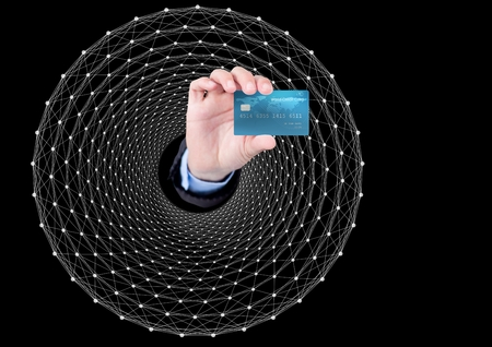 Digital composite of Hand Holding bank card against graphic dark background photo