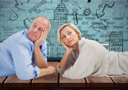 Digital composite of Mature couple against a wall with sketches