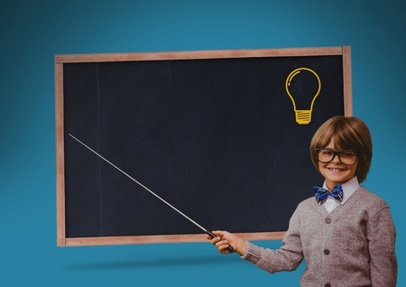 Digital composite of kid and blackboard with lightbulb against a blue background