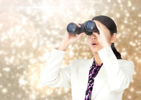 Digital composite of Businesswoman using binoculars against Sparkles light background