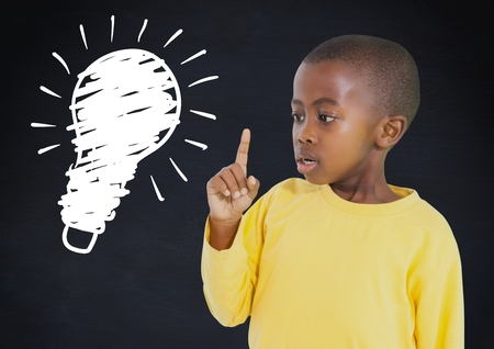 astonishing: Digital composite of kid and blackboard with lightbulb against a black background
