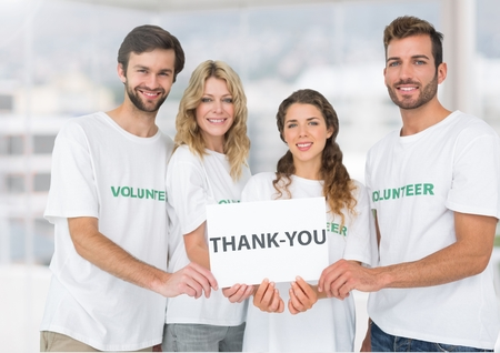 selfless: Digital composite of Happy Volunteer group showing Thank you sign against a light background