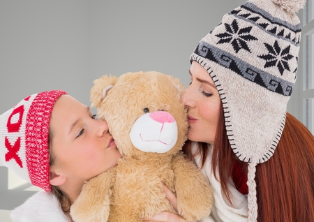 Digital composite of Mother and Daughter Kissing a Teddy Bear against a neutral background