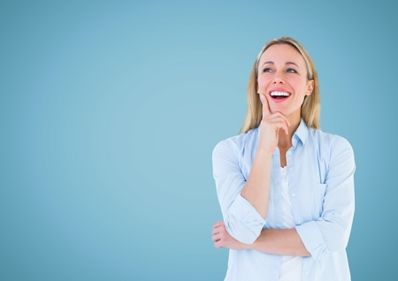 Digital composite of Happy Woman thinking against a light blue Background Stock Photo