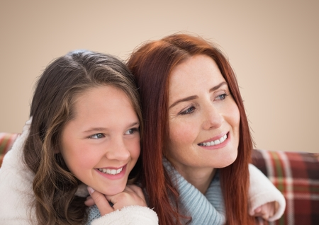 peering: Digital composite of Mother and Daughter Smilling against a neutral background