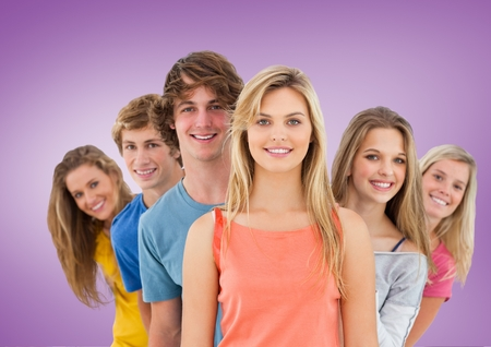 Digital composite of Group of Friends smiling at camera against a purple background Stock Photo