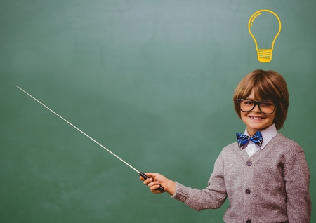 boy long hair: Digital composite of kid and blackboard with lightbulb against a black background