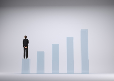 friend chart: Digital composite of Businesswoman standing on graph against grey background