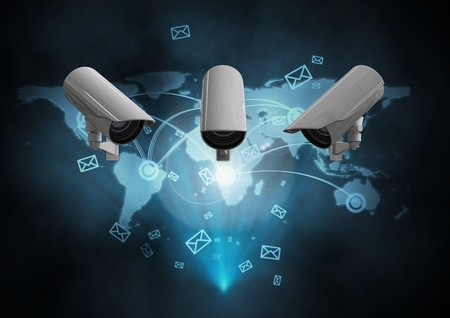 Digital Composite Image of a Security cameras against a dark blue map background Stock Photo