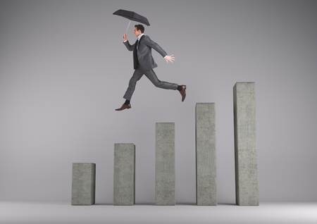 Digital composite of Businessman holding an umbrella jumping on a graph against a grey background