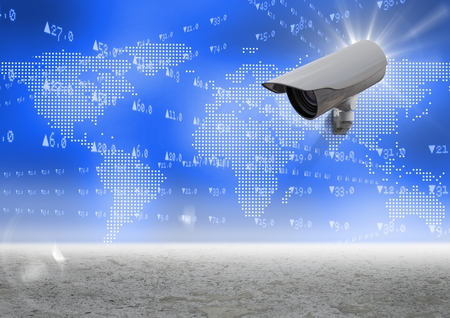 Digital Composite Image of a Security camera against blue map with sand background