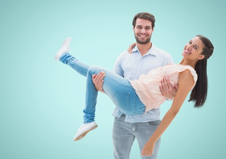 Digital composite of Happy Couple Having Fun against a blue Background Stock Photo