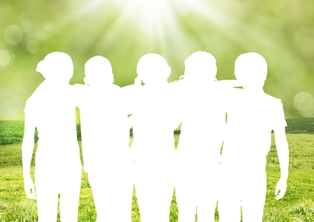 Digital Composite of silhouette of a group of friends against green background Stock Photo