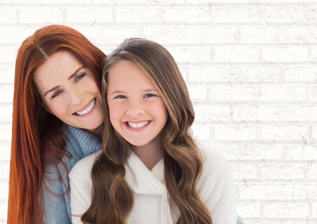 Digital composite of Mother and Daughter Smilling against a neutral background