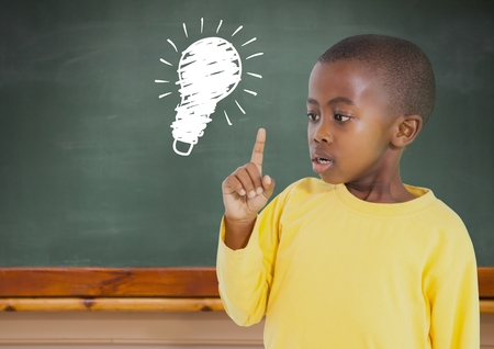 finding out: Digital composite of kid and blackboard with lightbulb against a black background