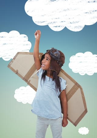 Digital composition of girl with artificial wings flying against sky in background