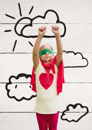 bacground: Girl in superhero costume standing with hands raised against wooden plank bacground Stock Photo