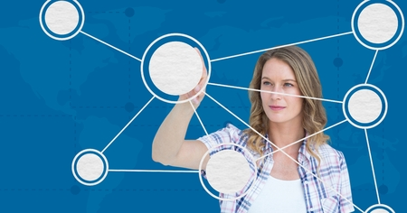 Woman touching digitally generated molecular structure against blue background
