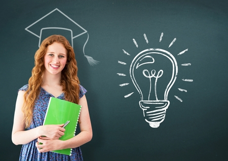 adult  body writing: Portrait of woman standing and holding book with graduation cap and light bulb in background Stock Photo
