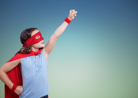 man looking out: Girl in superhero costume pretending to fly against green background Stock Photo