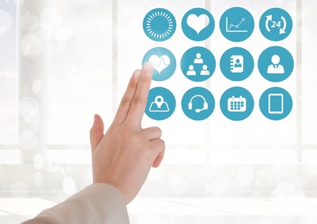 Digital composition of doctor touching digitally generated medical icons against white background Stock Photo